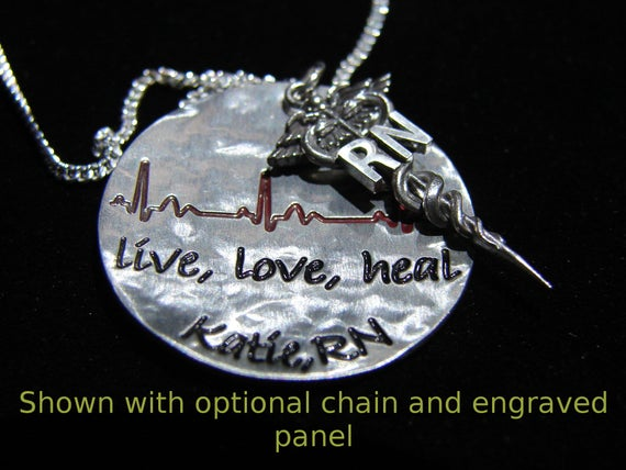 RN pendant. This Registered Nurse pendant is cast in sterling silver. The detail is extreme the quality is unmatched.