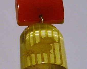 Bakelite reverse carved brooch bird in cage red and yellow jewelry