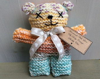 Hand knitted teddy bear based on East of India style
