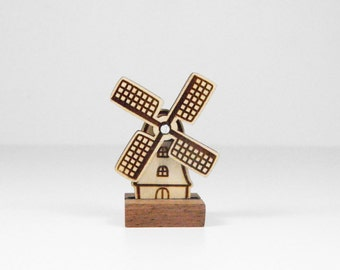 Wooden Dutch windmill with rotating blades