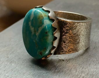 Size 9 Tufa Cast sterling silver ring with pilot mountain turquoise!
