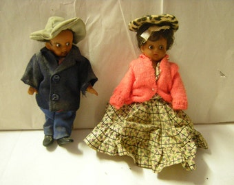 vintage rubber dolls-fully clothed-pioneer dolls-pioneer couple-rustic-