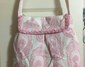 Pink and white shoulder bag