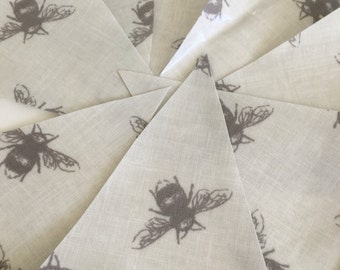 Bee oilcloth bunting for indoor and outdoor use