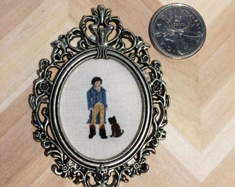 Miniature needlepoint portrait of a Regency gentleman and his dog
