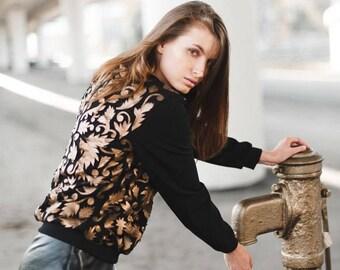 Sweatshirt with golden leather