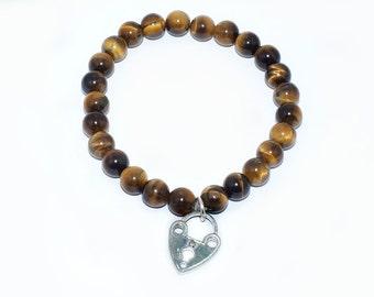 Tiger eye bracelet and silver heart.