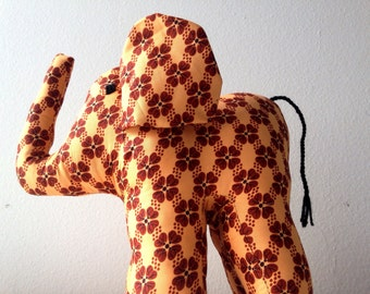 """Large african stuffed Elephant #1025 made by Ugandan Disabled Women. 10"""" height and 8"""" wide.  #runforherquick #SheisthatPerfectGiftyouneeded"""
