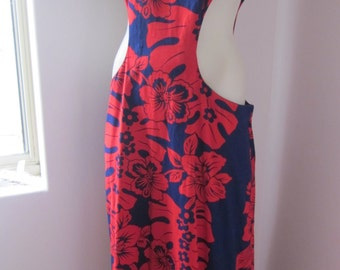 1960,s Hawaiian print maxi in cotton with cutoats at waist.Measures 36 inch waist and 40 inch hip