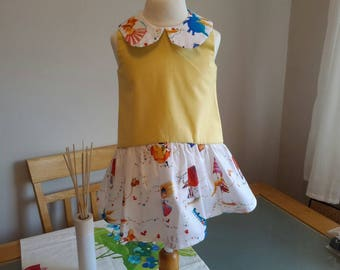 Girls sunshine yellow summer dress fairies and castle skirt in Spanish style of drop waist and Peterpan matching collar.