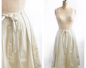 Sunburst seamed cotton beige midi skirt with adjustable waist and front buttons. Size XS/S.