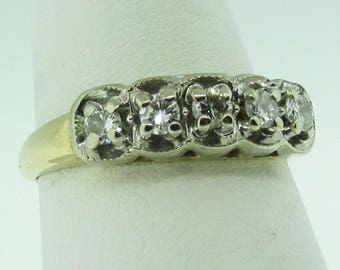 14K two-tone gold and diamond vintage wedding band.