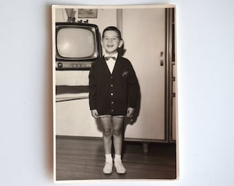 Happy days Smiling child and television, vintage photograph 1960s from Italy