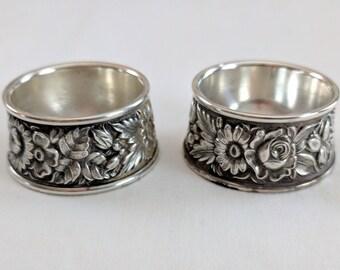 S. Kirk & Son, Inc. pair of sterling open salt cellars, floral repousse