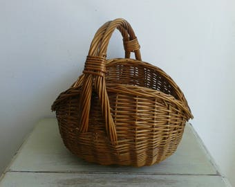 Lovely, rustic French vintage wicker gathering basket, circa 1930s.