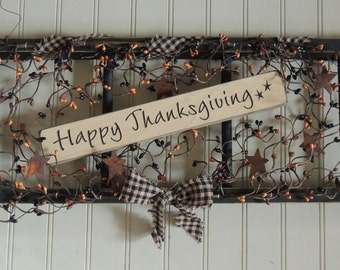 Thanksgiving primitive ladder with berries