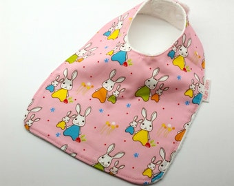 Baby Bib or Dribble Bib, cute Bunny Rabbits on Pink Cotton Fabric, Bamboo Toweling Backed, Snap Fastened, and Adjustable.
