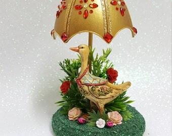 Decorated Goose Egg. Goose Under an Umbrella.