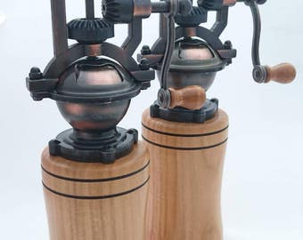 Antique pepper mills on a handturned Cherry base.