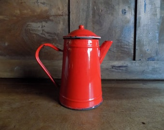 Retro French vintage red coffee pot /jug in enamelware, kitchen decor circa 1970s.