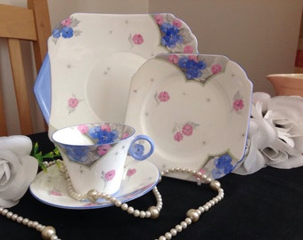 Shelley bone china set.   Rare pattern.  Pretty blues and pinks.