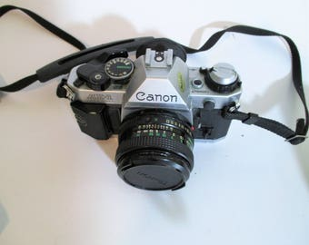Canon AE-1 Program 35 MM Camera, zoom lens, flash