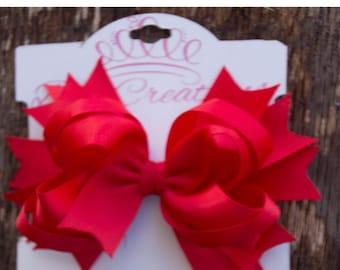 This beautiful hand made grosgrain clip Hair Bow is red tones