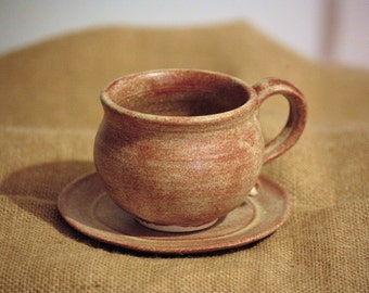 Ceramic tea/coffe cup and saucer.Rustic light brown colour.