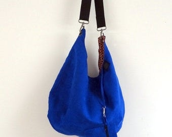 Patterned lining and electric Blue Suede Messenger bag