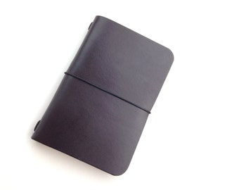 Moleskine Volant Cover. Brown Leather Minimalist Micro Notebook Cover Fits Volant extra small. Includes a notebook.
