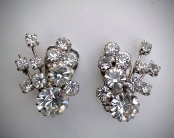 Vintage silver tone Continental clear rhinestone clip on earrings