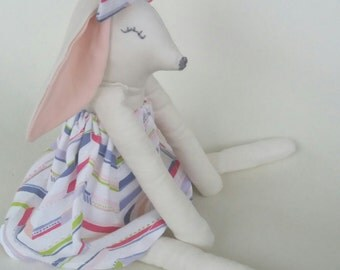 Soft toy rabbit, cuddly bunny, rabbit doll with hair bow.