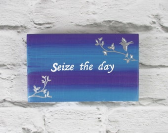 seize the day The two causes, epilepsy society and young epilepsy, joined forces with high street store river island to create a limited edition re-usable shopping bag bearing the slogan 'seize the day' around 10,000 bags were distributed to customers last week, to mark national epilepsy week, which ended on saturday.