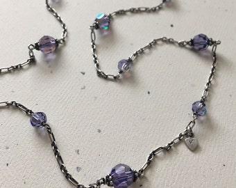 The Taylor Infinity Station Necklace in Tanzanite AB. Tanzanite AB Swarovski Crystal & Oxidized Sterling Silver Infinity Station Necklace