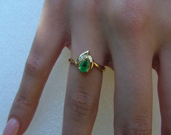 Emerald and diamond ring-dainty pear shaped Emerald surrounded by 3 diamonds