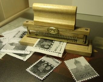 Cutter for making of postage stamps