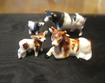 Two Sets of Miniature Bone China Cows with Calves