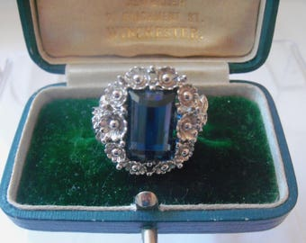 Wonderful Sarah Coventry deep blue baguette cut glass stone in ornate floral silver tone floral setting