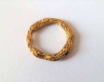 Round and hammered rings of antique gold color