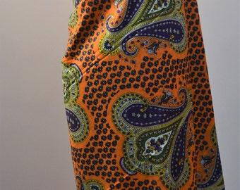 70s vintage retro dress making fabric. Orange with oversized purple paisley print. 2.8M x 119 CM