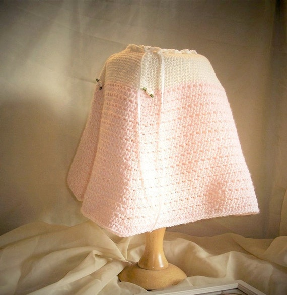 Baby Girl Cosy, Warm, Poncho crochete in soft cream and baby pink wool. Ribbon Tie neck, Rose bud detail. Age 3 - 12 months