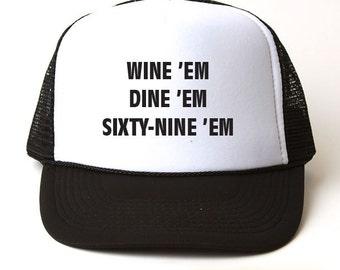Wine Em Dine Em Sixty Nine Em Trucker Hat