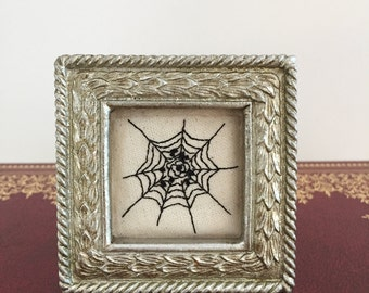 Mini spider web with flower embroidery