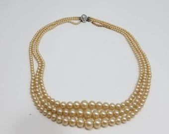 Classic Triple Strand Glass Pearl Necklace with Silver Tone Rhinestone Clasp