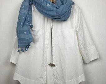 Crisp white cotton shirt with scalloped hem
