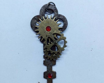 """Red mechanical"" key pendant"