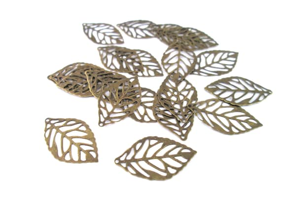 20 small filigree leaves, brass plated lead and nickel free, 24x14mm, D18