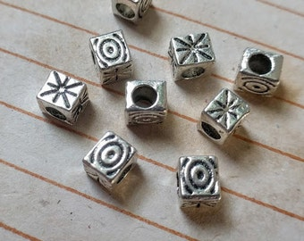 20 cube beads with star and eye pattern, silver tone, 5mm