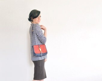 mod patent leather purse . shiny red matte navy blue . gold hardware