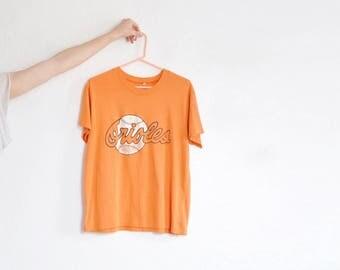 vintage Orioles team t shirt . orange athletic sports fan tee . Baltimore Maryland .mens medium